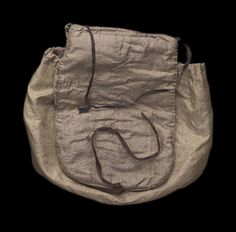 Work bag American, early 19th century Boston, Massachusetts, United States DIMENSIONS 27 x 28 x 3.5 cm (10 5/8 x 11 x 1 3/8 in.) MEDIUM OR TECHNIQUE Silk plain weave, wool twill, cotton plain weave (tape), leather (needle case), silk-covered button