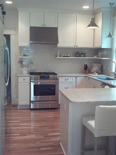 white cabinets, white countertops, white subway tile, slide in range, undermount sink and stainless steel appliances. An almost perfect insipiration pic.
