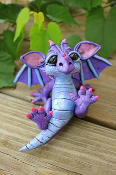 oh my gosh!! I have got to make this out of fondant to put on a castle cake - *CLAY ~ Purple Dragon by Miranda Farrand of Miranda's Critters
