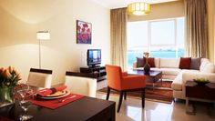 Apartments:Modern Living Room With Wooden Dining Sets Plus White Sofa Ling Room With Cushions Plus Coffee Table And Television Vanity Along With Pendant Light Also Floor Lamp And Marble Floor As Well As Curtains Outstanding Modern Living Room with Luxurious Design