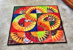 Fiesta NY Beauty quilted wall hanging table by GoodiesByJamieThe 7th Entry into our QQQ Quilt of the Month Contest this month of May. WOW STUNNING!