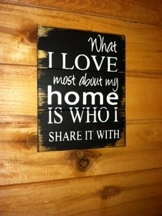 """What I love most about my home is who I share it with  Pint-sized sign measures 8""""w x 10 1/2""""h Hand-painted wood sign"""