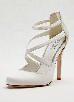 "Truly Zac Posen ankle-strap satin pump.  Satin closed toe ankle-strap pump with piped trim and comfort-padded insole.  Heel height: 4 1/4"". Platform height: 1/4"".  Available in Ivory and Portobello.  Imported."