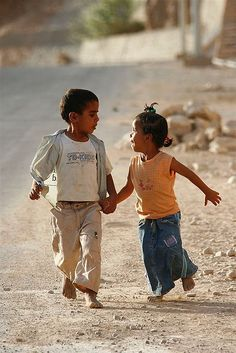 Young boy and girl holding hands - Yemen ©  Eric Lafforgue, via Flickr