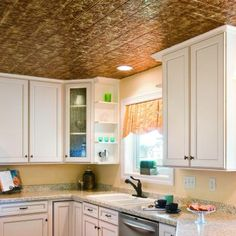 Accord a delightful and pleasing accent to your home with the choice of this excellent Fasade Traditional Style Glue Up PVC Ceiling Tile in Bermuda Bronze. Pvc Ceiling Tiles, Ceiling Panels, Ceiling Materials, Backsplash Panels, Home Kitchens, Home Remodeling, Kitchen Remodel, New Homes, House Design