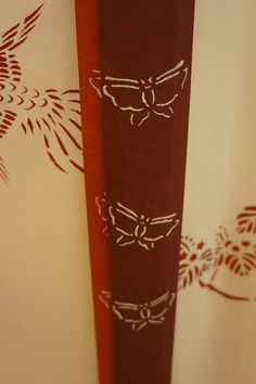 A close up of the pattern on a heian era curtained bed.