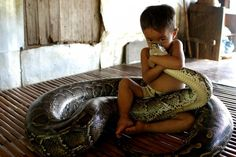 Boy Hugs Snake