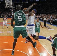 Carmelo Anthony,  looks to take Game 2 against Kevin Garnett, in the Quarterfinals of the 2013 NBA Playoffs