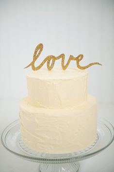 "Gold glitter ""LOVE"" script wedding cake topper"