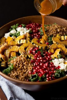 This Autumn Harvest Salad uses the beautiful produce available as the months start to get colder, such as delicata squash, kale, and pomegranates, as well as farro and goat cheese to make a hearty cold weather salad. Then it is all tossed together with a Whole Food Recipes, Cooking Recipes, Healthy Recipes, Fall Vegetarian Recipes, Wild Rice Recipes, Vegetarian Salad, Cooking Games, Sweet Potato Recipes, Drink Recipes