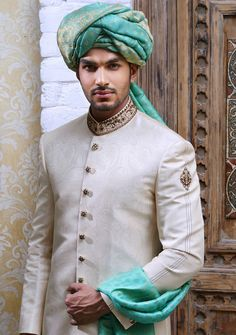Jamawar sherwani outfit for grooms wedding in off white color by fashion designer Amir Adnan UK. Buy custom sherwani suits for your big day at best price Indian Wedding Gowns, Wedding Dress Men, Indian Bridal Fashion, Pakistani Wedding Dresses, Wedding Men, Wedding Groom, Wedding Suits, Punjabi Wedding, Indian Weddings