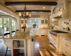 I'm finding that I love white cabinets, but I really like the warmth this kitchen has, white cabinets with warm counters and flooring.