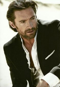 Hugh Jackman. He can Wolverine my heart any time! ...yes, I'm aware that made absolutely no sense. *waves giant fan sign* HUGH JACKMAN I LOVE YOUUUU