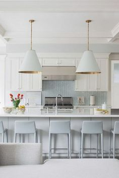 Light blue herringbone backsplash in a white kitchen with a couple of our favorite chandeliers! Kitchen And Bath, New Kitchen, Kitchen Dining, Kitchen Decor, Kitchen Modern, Kitchen White, Pastel Kitchen, Kitchen Ideas, Kitchen Island