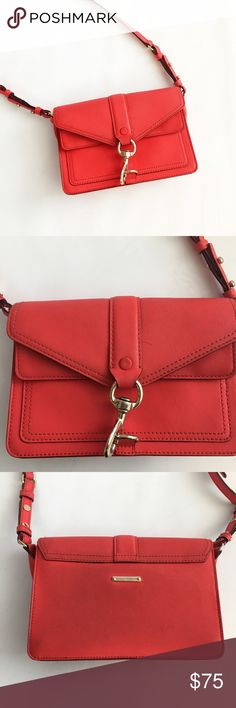 """Rebecca Minkoff Red Hudson Moto Mini Crossbody Well loved moto bag in firey red color and gold toned hardware. Leather. Features clip-lock closure, adjustable strap, exterior slip pocket under flap with magnetic closer. Inside has wall pocket and divider to keep your things organized.  H: 7"""" L: 9"""" D: 3"""" Strap drop: 20.75""""  USED condition and has some discoloration from denim transfer. Also some pen(?) marks and scratched hardware. Still in great shape besides the cosmetic issues and has a…"""