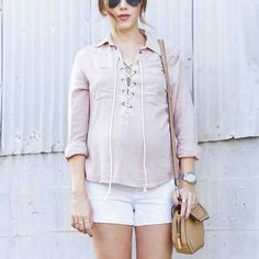 pink lace-up top, white shorts
