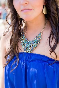 Stunning statement necklace for the bridesmaid in blue {Photo by Erin Lindsey Images via Project Wedding}