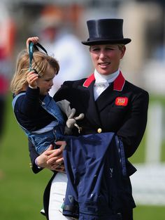 Zara Phillips Photos - Zara Phillips with daughter Mia looks on during Day Three of the Badminton Horse Trials on May 6, 2016 in Badminton, Gloucestershire. - Badminton Horse Trials - Day Three
