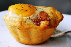 Bacon and Egg Savory Cupcakes   Spray 8 jumbo muffin cups or 8 (6-oz) glass custard cups with cooking spray. Separate dough into 8 biscuits. Place 1 biscuit in each muffin cup, pressing dough three-fourths of the way up sides of cups. Place 2 bacon slices in each biscuit cup, and crack an egg over each. Season with salt and pepper. 350 for 25-30 min.