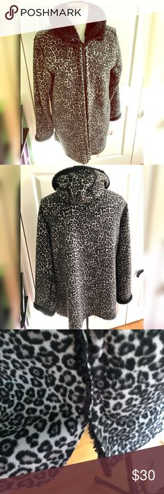 Leopard Jacket Brand new. Tried on once, took the tags off and realized it was too short in my arms. Size large. I believe the brand was Laura Ashley. It doesn't say inside the jacket. Extremely warm and comfortable. Gorgeous black and gray leopard. Has a hood as well for some extra coverage. Not looking to trade. Laura Ashley Jackets & Coats