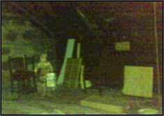 This is a picture in the attic at the photographer's friends house; the girl was not in the picture when it was taken.