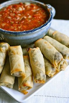 Healthy oven toasted spring rolls with fresh salsa.