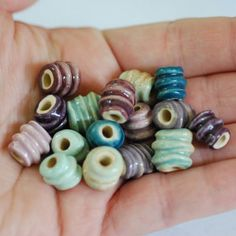 This Etsy artist makes gorgeous ceramic beads of many different shapes and sizes.  MarshaNealStudio on Etsy.com. Handmade Ceramic Spiral Bead Sets 8 Pairs Made To Order You PIck The Color Palette