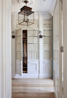 How fabulous is this closet area!!! Designed by the British architectural firm, Hayburn and Company.