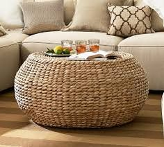 pouf coffee table: round woven coffee table 399 we love that this coffee table is shaped after one of our furniture faves the pouf this hand woven coffee table has an