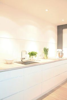 Contemporary minimalist clean all white kitchen.