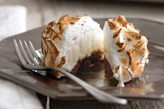 A dessert classic, this elegant rendition of Baked Alaska features a blanket of golden-brown meringue wrapped around a scoop of dreamy vanilla ice cream.