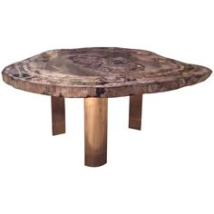Karl Springer Petrified Wood Table with Brass Legs | From a unique collection of antique and modern coffee and cocktail tables at https://www.1stdibs.com/furniture/tables/coffee-tables-cocktail-tables/
