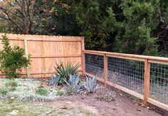6ft cedar privacy fence to 4ft cattle panel fence. Find cattle panels on mccoys.com #cattlepanel #fencing