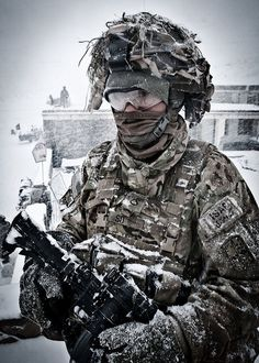 U.S. Army Pfc. Dewey So endures the harsh blast of an Afghan winter storm in the village of Marzak Jan. 15, 2012. Photo by Staff Sgt. Charles Crail.