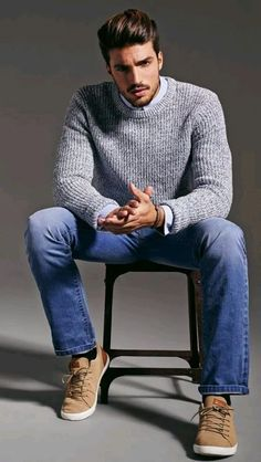 Go for a grey cable sweater and blue jeans for a casual and stylish look. Tan plimsolls tie the ensemble together.
