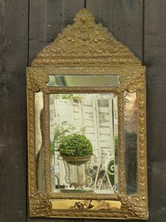 Napoleon III mirror with original glass and moulded metal frame