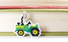Hey, I found this really awesome Etsy listing at https://www.etsy.com/listing/209677805/green-tractor-charm-beaded-farm-vehicle