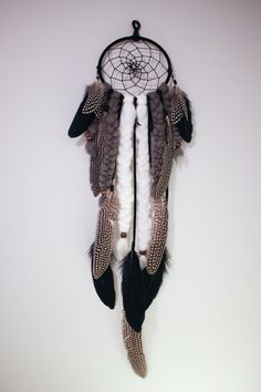 The Coyote Dreamcatcher - Traditional Dream Catcher, Leather Lace with Accent feathers, Beads, Braided Wool Roving, by TheDreamerWeaver on Etsy https://www.etsy.com/listing/478335807/the-coyote-dreamcatcher-traditional