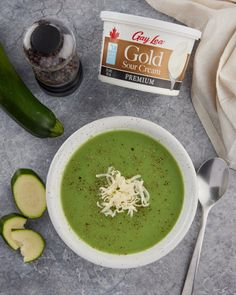 Get your veggies in with this vibrant and nourishing Cream of Zucchini Soup, made with Gay Lea's Gold Sour Cream! 🥒 Zucchini Soup, Palak Paneer, Sour Cream, Gay, Veggies, Favorite Recipes, Vibrant, Ethnic Recipes, Food