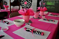 Pink Zebra flowers for Baby Shower.  Cut out little rattles with Cricut machine and added to ribbon for napkin ring.