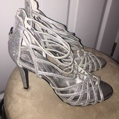 Silver Nina Ricci Heels These beautiful heels are in perfect condition! They've only been worn once for New Years a few years ago. Size is a Woman's 10. Super gliterry & fun! Nina Ricci Shoes Heels