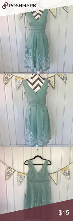 """Embroidered Day Dress Beautiful blue green dress with white embroidered pattern around the bottom. Measures 40"""" long. Very good used condition. Fully lined. Dress 100% cotton. Lining a silky 100% polyester. Zipper closure down the back. Dress Barn Dresses"""