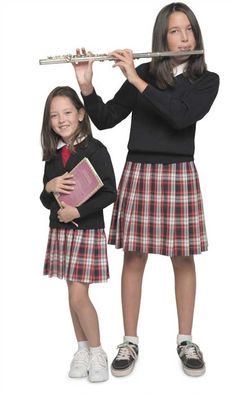 Since the early days of universities, scholars have worn uniform clothing.  The pleated plaids seen in many students' uniforms today originate from the tartan kilts of the Scottish. -  It wasn't until the 1960s that uniforms became the norm in American Catholic schools, which some educators believe equalize social classes and foster a studious environment. These days, uniforms programs are common in private and parochial schools, and even in a portion of independent and public schools