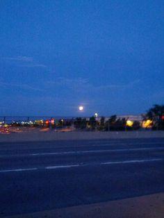 Cool, halloweenish moon overlooking freeway from Power-Mesa
