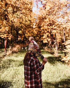 autumn and fall aesthetic | plaid flannel, Pom Pom knit beanie, bouquet of flowers, autumnal leaves and trees