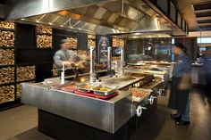A customized grill with 3 -separate grilling sections for seafood, meats, and fruits/vegetables.