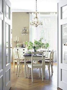 Like the idea of doors like this separating the kitchen and dinning room or family room.. And the herringbone floor