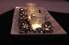 Winter Centerpiece - glitter votive holders, tea light candles, and jingle bells on a white tray