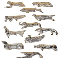 Exquisite Set of 12 Art Deco Silver-Plate Knife Rests by GALLIA, ca. 1930. This gorgeous set of 12 knife rests feature stylized animals in a Cubist Art Deco manner. These are in mint condition and have the original box from Paris. (hva)