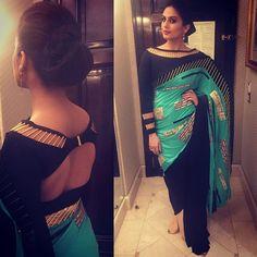Tonight's look styled by @aasthasharma612 ... a gorg #shivannarresh sari and a twisty bun #IIFARocks